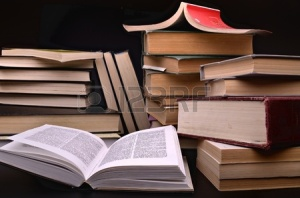 11549095-open-book-and-pile-of-books-against-a-dark-background